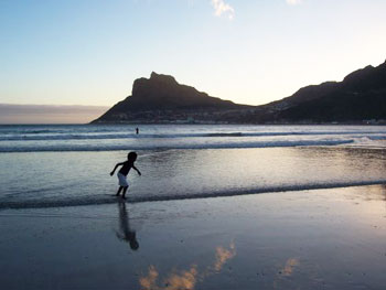 A view like this, of the Hout Bay beach at dusk, will cost you absolutely nothing