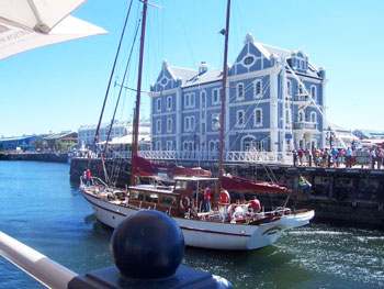 The Victoria and Albert Waterfront is a shopping and entertainment complex set in a working harbor.