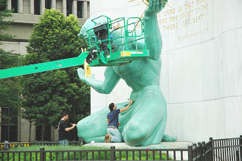 Cleaning Detroit's iconic statue, center of the city.
