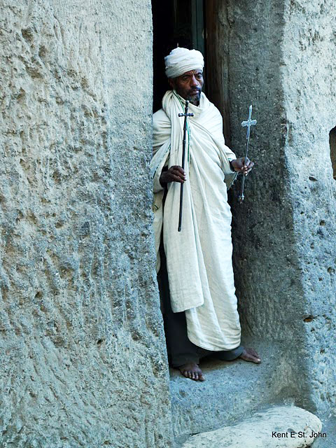 A monk blesses pilgrims at Ashetan Maryam high above Lilibela. Ethiopia