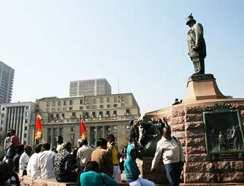 The Statue of old-President Paul Kruger peers pensively at the hubbub that surrounds him every day at Church Square.