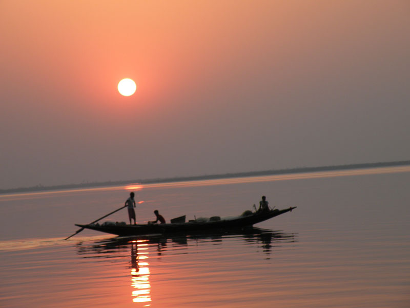 A dinghy at sunset in the Sundarbans. Photo by Swati Dasgupta.