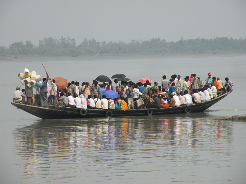 Sharing uncomfortable space in typically perilous overcrowding. A heavily laden vessel in the Sundarbans. Photo by Swati Dasgupta.