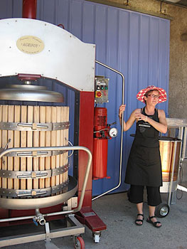 Caroline Feely demonstrates her winemaking equipment at Chateau Haut Garrigue.