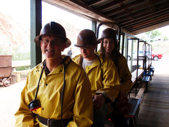 Don, Mike and Sara Bruschi take the miners' train down 1,500 feet into the Queen Mine.