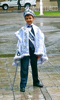 A boy dressed in traditional Turkish circumcision garb