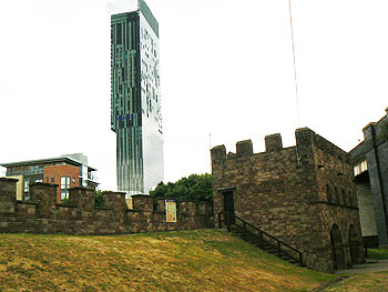 The futuristic Deansgate Hilton Hotel rises above ancient fortifications in Castlefield.