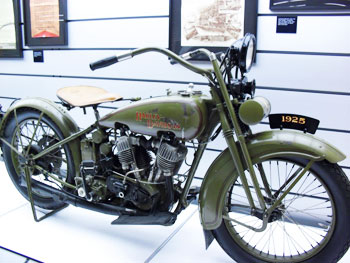 A vintage motorcycle on display at the Harley Davidson Museum
