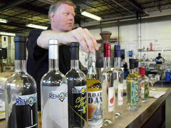 The owner of the Great Lakes Distillery give details about each liquor produced there on one of the distillery tours.