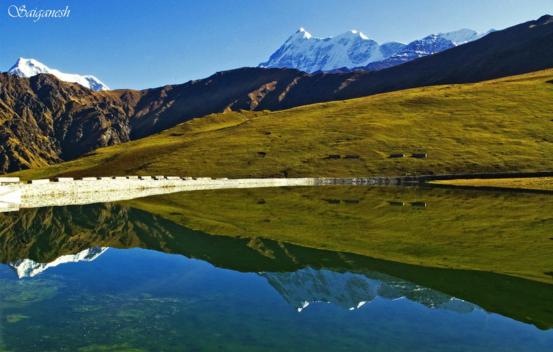 Nandaghunti and Trishul reflected over the placid waters of the sacred Bedni kund in Uttarakhand, India