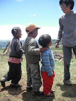 Nomad children enjoying the sunny weather