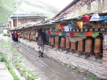 Prayer wheels outside Tagong Monastery