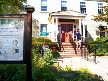 A steady flow of bookworms pass through the Greenfield Public Library on Main Street.