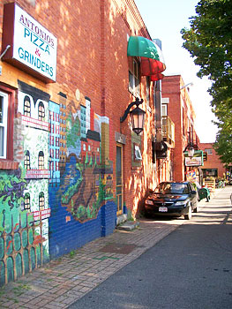 Wall art brightens the corner at Antonio's Pizza.