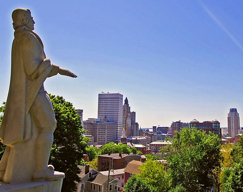 Roger Williams statue overlooking the Providence skyline