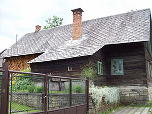 Traditional Wallachian house with puzzle-like wood stack