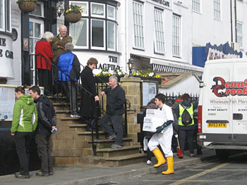 A line forms at The Magpie Cafe on Whitby's Pier Road as early as 11am and sometimes before the fish has arrived.