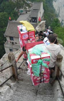 A porter hauls a heavy load.