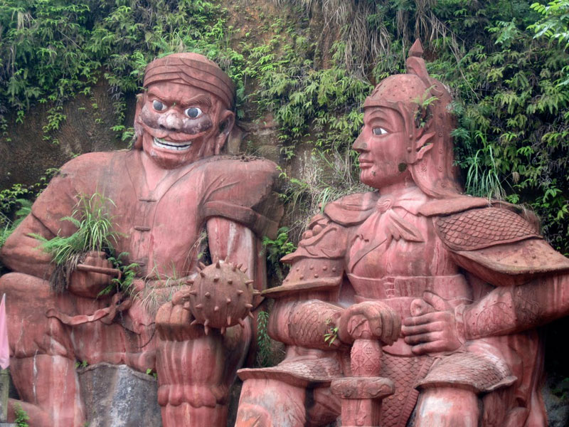 Giant statues oversee the grounds at Tusi Castle in Enshi, China.