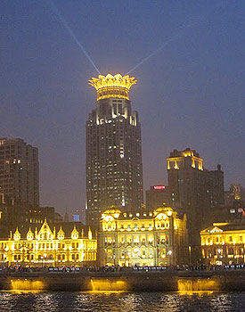 The Bund of Shanghai is all lit up for the evening.