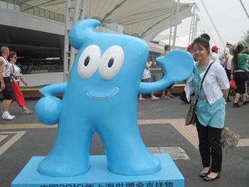 My guide, Vivi, poses with the original Haibao figure.