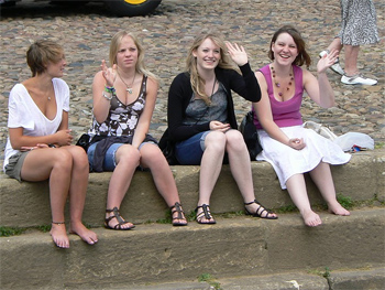 Girls waving from the banks of the River Ouse, York England. photo by Max Hartshorne.