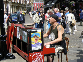 Boogie woogie piano man jamming in the center of York, England. photos by Max Hartshorne
