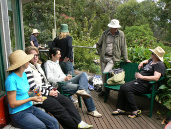 Everyone wears floppy hats while sitting in the Australian sun.
