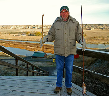 Wahkpa Chu'gn is the most extensive and best preserved Native American hunting ground and buffalo bone deposit in the northern Great Plains. In this photo, John Park is holding the atlatl, an ancient weapon.