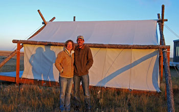 Sarah and Jacob Dusek, owners of Sage Safaris. The tent in the background is for 'glampers'.
