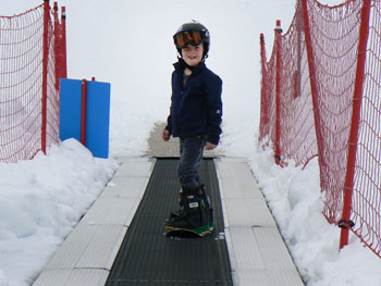 Aboard the Magic carpet at Snowbasin, where little kids learn to snowboard.