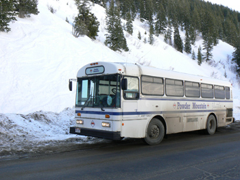 Do it by bus! Powder Mountain's ski bus takes skiiers all the way to the top 9600 feet, at Snowbasin.