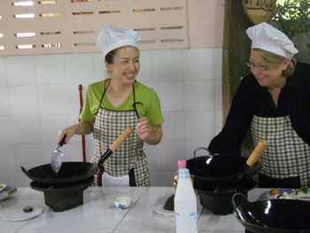 Pam, left, teaches at Baan Hongnual Cookery School in Thailand.