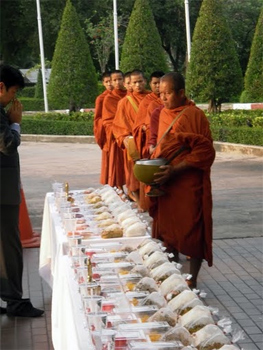 Monks before their offering, in Bangkok, Thailand.