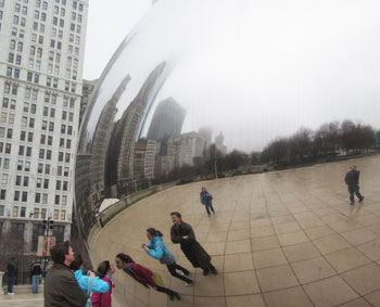 People (myself included) play around with the many photo opportunit?ies the Bean provides.