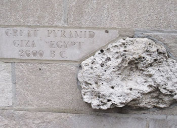 The walls of the Tribune Tower house famous rocks from all over the world.  In this case, a piece of the Great Pyramid is shown.
