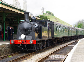 The Steam Train arrives in Corfe Castle. The train is manned by volunteers and railway enthusiast?s and takes passengers from Norden to Swanage in authentic carriages.