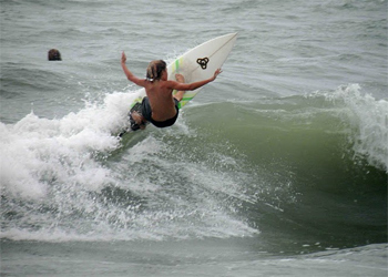 Whether ripping it yourself or watching from the beach, Canoa has some great surfing and surfers. Photo: CanoaThril?ls.com