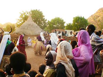 Villagers watch the Kambala dancers