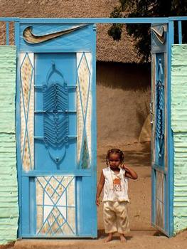 Cute Sudanese girl watching us