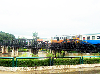 The Bridge over the River Kwai in action as trains travel through it. Built during the Second World War, the monument is made famous by the novel and Oscar winning film named after it.