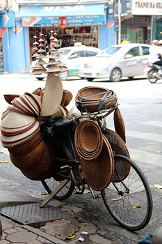Hat and basket vendor, Hanoi.