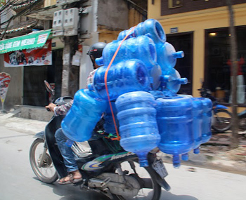 Motorbike with a full load in Hanoi, Vietnam.