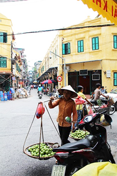 Vendor in Hanoi. photos by Kathleen Broadhurst.