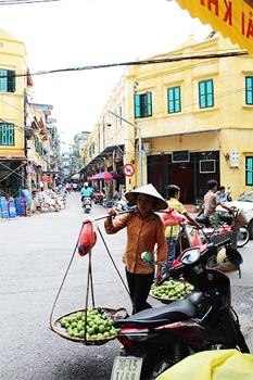 Vendor in Hanoi. photos by Kathleen Broadhurst.