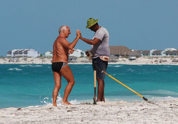 Tourist and Cuban worker connecting