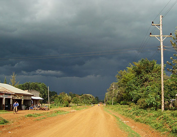 The main road in Sigomere, just before a rainstorm. Photo by Marianne Stenger.