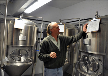 Brewmaster David Beardsell in his laboratory at the Noble Pig Brewhouse. Photo by Robin Schroffel.