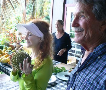 Lilly and Chuck Boener of Ono Farms with a happy customer and her durian fruit.