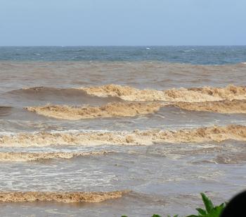 Muddy waves after a big rainstorm in Hana, Maui.